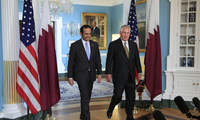 Secretary of State Rex Tillerson escorts Qatar's Foreign Minister Sheikh Mohammed bin Abdulrahman Al Thani to the Treaty Room of the State Department in Washington, Wednesday, July 26, 2017. (AP Photo/Manuel Balce Ceneta)