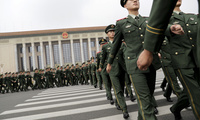 Chinese paramilitary policemen march outside the Great Hall of the People after attending a ceremony to commemorate the 90th anniversary of the founding of the People's Liberation Army in Beijing, Tuesday, Aug. 1, 2017. (AP Photo/Andy Wong, Pool)