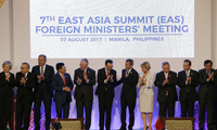 Foreign Ministers, from nearly a dozen nations applaud after a group photo at the start of the 7th East Asia Summit Foreign Ministers' Meeting, as part of the 50th ASEAN Ministerial Meetings in Manila, Philippines on Aug. 7, 2017. (AP Photo/Aaron Favila, Pool)