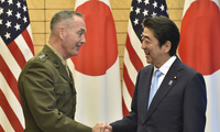 Chairman of the Joint Chiefs of Staff Joseph Dunford, left, shakes hands with Japanese Prime Minister Shinzo Abe prior to a meeting at Abe's official residence in Tokyo on Friday, Aug. 18, 2017. (Kazuhiro Nogi/Pool Photo via AP)