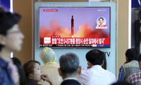 People watch a TV screen showing file footage of a North Korean missile launch, at the Seoul Railway Station in Seoul, South Korea on Aug. 29. (AP Photo/Ahn Young-joon)