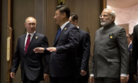 From left, Russian President Vladimir Putin, Chinese President Xi Jinping and Indian Prime Minister Narendra Modi arrive for the Dialogue of Emerging Market and Developing Countries in southeastern China on Tuesday, Sept. 5, 2017. (AP Photo/Mark Schiefelbein, Pool)