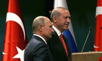 Turkey's President Recep Tayyip Erdogan, right, and Russian President Vladimir Putin walk after a news conference and talks in Ankara, Turkey on Sept. 28, 2017 (AP Photo/Burhan Ozbilici).