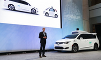 John Krafcik, CEO of Waymo Inc., the autonomous vehicle company created by Google's parent company, introduces a Chrysler Pacifica hybrid outfitted with Waymo's own suite of sensors and radar at the North American International Auto Show in Detroit on Jan. 8, 2017. AP Photo/Paul Sancya, File.