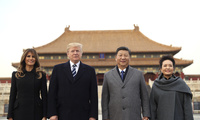 President Donald Trump, second left, first lady Melania Trump, left, Chinese President Xi Jinping, second right, and his wife Peng Liyuan, right, stand together as they tour the Forbidden City in Beijing, on Wednesday, Nov. 8, 2017. (AP Photo/Andrew Harnik)
