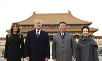 President Donald Trump, second left, first lady Melania Trump, left, Chinese President Xi Jinping, second right, and his wife Peng Liyuan, right, stand together in Beijing, China on Wednesday, Nov. 8, 2017. (AP Photo/Andrew Harnik)