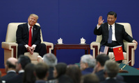 U.S. President Donald Trump, left, reacts as Chinese President Xi Jinping waves to business delegates during a business event at the Great Hall of the People in Beijing on Thursday, November 9, 2017. Trump is on a five-country trip through Asia traveling to Japan, South Korea, China, Vietnam and the Philippines. (AP Photo/Andy Wong)