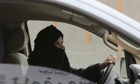 Aziza Yousef drives a car on a highway in Riyadh, Saudi Arabia, as part of a campaign to defy Saudi Arabia's ban on women driving. The ban is expected to end in June 2018. March 29, 2014. (Hasan Jamali/Associated Press, File). Keywords: Aziza Yousef, Saudi driving ban