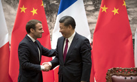 French President Emmanuel Macron, left, and Chinese President Xi Jinping shake hands after a joint press briefing at the Great Hall of the People in Beijing on Jan. 9, 2018 (AP Photo/Mark Schiefelbein, Pool).