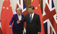 Chinese President Xi Jinping, right, and British Prime Minister Theresa May gesture ahead of a meeting at the Diaoyutai State Guesthouse in Beijing. February 1, 2018 (Wu Hong/Pool Photo via Associated Press).