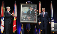 Defense Secretary James Mattis, left, applauds former Defense Secretary Ash Carter, right, during the portrait unveiling ceremony for the former secretary at the Pentagon on Friday, Feb. 2, 2018. (AP Photo/Jacquelyn Martin)