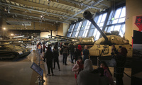Visitors walk past a display of Cold War-era tanks at the Royal Tank Museum in Amman, Jordan on Thursday, February 1, 2018. (AP Photo/Sam McNeil)