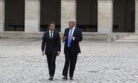 In this July 13, 2017 file photo French President Emmanuel Macron listens to U.S. President Donald Trump, right, in the courtyard of Les Invalides after a welcoming ceremony in Paris. (Yves Herman, Pool via AP, File)