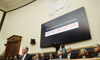 The national debt is shown behind Federal Reserve Chairman Jerome Powell, left, as he makes the semiannual monetary policy report to the House Financial Services Committee in Washington. February 27, 2018 (Jacquelyn Martin/Associated Press). Keywords: national debt, Jerome Powell, Federal Reserve