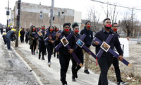 High school senior D'Angelo McDade, front right, leads a march in Chicago's North Lawndale neighborhood during a walkout to protest gun violence and show solidarity with survivors of the shooting in Parkland Fla., on Wednesday, March 14, 2018. (AP Photo/Martha Irvine)