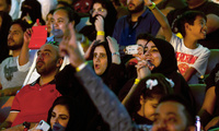 "Fans react as they watch the ""Greatest Royal Rumble"" event in Jeddah, Saudi Arabia, Friday, April 27, 2018. A previous WWE event held in 2014 was for men only, but Friday night's event included both women and children in attendance. AP Photo/Amr Nabil"