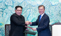 In this April 27, 2018 file photo, North Korean leader Kim Jong Un, left, and South Korean President Moon Jae-in shake hands after signing on a joint statement at the border village of Panmunjom in the Demilitarized Zone, South Korea. (Korea Summit Press Pool via AP)