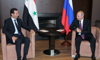 Russian President Vladimir Putin, right, listens to Syrian President Bashar al-Assad during their meeting in the Black Sea resort of Sochi, Russia, Thursday, May 17, 2018.
