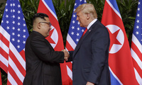 North Korea leader Kim Jong Un and U.S. President Donald Trump shake hands