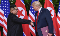 North Korea leader Kim Jong Un and U.S. President Donald Trump shake hands at the conclusion of their meetings at the Capella resort on Sentosa Island June 12, 2018 in Singapore. (AP Photo/Susan Walsh, Pool)