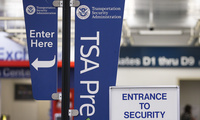 A TSA pre check sign at a security checkpoint is on display for travelers to easily see at the Fort Lauderdale–Hollywood International Airport on Friday, June 29, 2018, in Fort Lauderdale, Fla. The TSA projected that Friday would be its busiest day ever, with agents screening more than 2.7 million people.