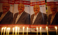 In this October 25, 2018, photo, candles, lit by activists, protesting the killing of Saudi journalist Jamal Khashoggi, are placed outside Saudi Arabia's consulate, in Istanbul, during a candlelight vigil.