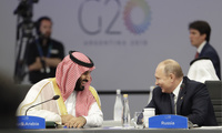 Saudi Arabia's Crown Prince Mohammed bin Salman, left, and Russia's President Vladimir Putin, right, speak at the start of the G20 summit in Buenos Aires on November 30, 2018.