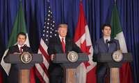 President Donald Trump, center, Canada's Prime Minister Justin Trudeau, right, and then-Mexican President Enrique Pena Nieto hold a joint news conference before signing a new United States-Mexico-Canada Agreement in Buenos Aires, Argentina on Nov. 30, 2018 (AP Photo/Martin Mejia).