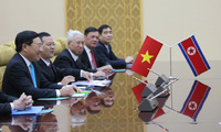 The delegation of the Vietnamese Foreign Ministry led by Foreign Minister Pham Binh Minh, left, meets with North Korea Foreign Minister Ri Su Yong at the Mansudae Assembly Hall in Pyongyang, North Korea, on Feb. 13, 2019 (Cha Song Ho/Associated Press).