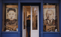 Artworks featuring U.S. President Donald Trump and North Korean leader Kim Jong Un are displayed at a gallery in Thursday, Feb. 28, 2019, Hanoi, Vietnam.