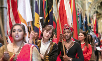 Flag bearers carrying the flags of the Commonwealth through Westminster Abbey