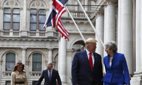 Britain's Prime Minister Theresa May and her husband accompany U.S. President Donald Trump and his wife during the latter couple's visit to the UK, June 4, 2019.