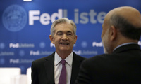 Federal Reserve Chairman Jerome Powell (L) speaks at a conference about the Fed's planned interest-rate strategy, June 4, 2019.