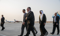 Secretary of State Mike Pompeo, center, walks with U.S. Charge d'Affaires Steve Bondy, left, and United Arab Emirates Minister of State Ahmed al-Sayegh, right, upon arrival in Abu Dhabi, United Arab Emirates on June 24.