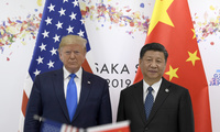 President Donald Trump, left, poses for a photo with Chinese President Xi Jinping.