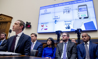"The words ""If Consumers Use Libra, Who Would They Be Dealing With?"" is displayed on a monitor behind Facebook CEO Mark Zuckerberg as he testifies before a House Financial Services Committee hearing on Capitol Hill in Washington, Wednesday, Oct. 23, 2019, on Facebook's impact on the financial services and housing sectors."