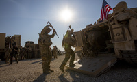 Crewmen enter Bradley fighting vehicles at a US military base at an undisclosed location in Northeastern Syria.