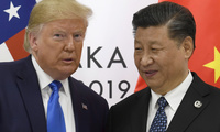In this June 29, 2019, file photo, U.S. President Donald Trump poses for a photo with Chinese President Xi Jinping during a meeting on the sidelines of the G-20 summit in Osaka, western Japan.