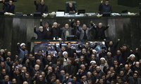 Photo of Iranian lawmakers chant anti-American and anti-Israeli slogans to protest against the U.S. killing of Iranian top general Qassem Soleimani, at the start of an open session of parliament in Tehran, Iran, Sunday, Jan. 5, 2020. Soleimani's death Friday in Iraq further heightens tensions between Tehran and Washington after months of trading attacks and threats that put the wider Middle East on edge.