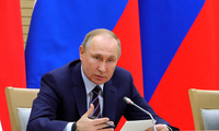 Photo of Russian President Vladimir Putin speaks as he chairs a meeting on drafting constitutional changes at the Novo-Ogaryovo residence outside Moscow, Russia, Thursday, Jan. 16, 2020. Putin proposed a set of constitutional amendments that could keep him in power well past the end of his term in 2024.