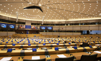 A MEP walks in the mostly-vacant Plenary chamber of the European Parliament in Brussels, Tuesday, March 10, 2020.