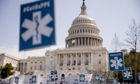 Advocacy groups display a thousand signs that read #GetUsPPE, along images of health care workers, in a call for personal protective equipment for frontline health workers during the coronavirus outbreak, on the West Lawn of the U.S. Capitol, Friday, April 17, 2020, in Washington.
