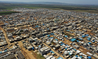 A large refugee camp on the Syrian side of the border with Turkey, near the town of Atma, in Syria's Idlib province, April 19, 2020.