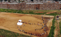 Residents from the Alexandra township in Johannesburg gather in a stadium to be tested for COVID-19 Wednesday, April 29, 2020.
