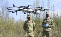 Russian National Guard soldiers operate a surveillance drone in Losiny Ostrov national park in northeastern Moscow, Sunday, May 3, 2020.