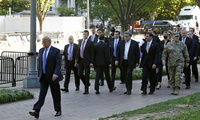 Photo of President Donald Trump, Secretary of Defense Mark Esper, and others walk in Lafayette Park for a photo outside St. John's Church across from the White House Monday, June 1, 2020, in Washington.