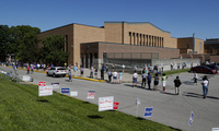 Voters wait in a line outside Broad Ripple High School to vote in the Indiana primary in Indianapolis, Tuesday, June 2, 2020 after coronavirus concerns prompted officials to delay the primary from its original May 5 date.