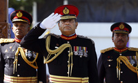 Sri Lankan army commander Lt. Gen. Jagath Jayasuriya, center, salutes as the next Army Commander Major Gen. Daya Ratnayake, left, and Major Gen. Jagath Dias watch a military parade in Colombo, Sri Lanka, Tuesday, July 30, 2013. Ratnayake is the Sri Lankan army's 20th commander designate and will resume duties from August 1, 2013. (AP Photo/Eranga Jayawardena)