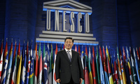 Chinese President Xi Jinping poses for photographers after delivering his speech, during a visit at the UNESCO headquarters, in Paris, Thursday March 27, 2014.