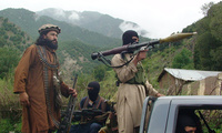 Pakistani Taliban patrol in their stronghold of Shawal in Pakistani tribal region of South Waziristan on August 5, 2012.